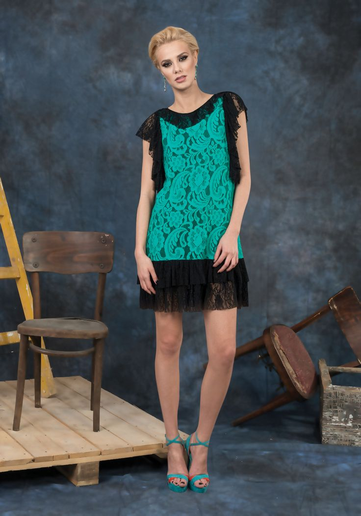 Short black and green lace dress . You can wear it in the evening or at parties. The ruffles give the dress a feminine and playful vibe.