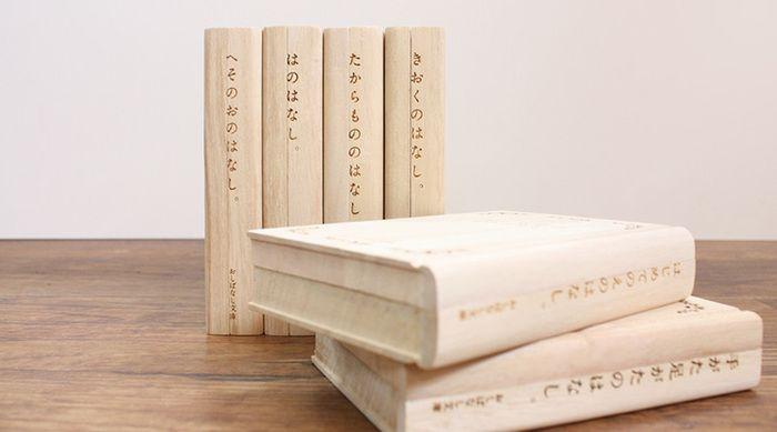 """「おしばなし文庫」とは、桐で作った文庫型ケースのシリーズです。 へその緒、手形、写真の数々など、保存が難しいけれど、大切に取っておきたい愛する子供の成長の証を、押し花を挟むように保管できる新しいかたちの""""タイムカプセル""""です。"""