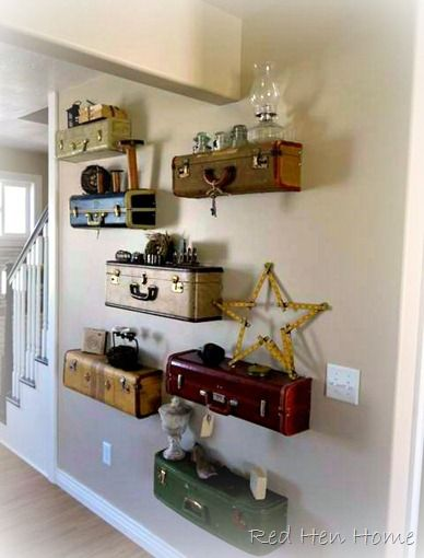 Vintage suitcases cut into shelves - be sure to use a metal blade on the table saw if there's a metal band. http://redhenhome.blogspot.com/2012/05/spring-suitcase-wall.html