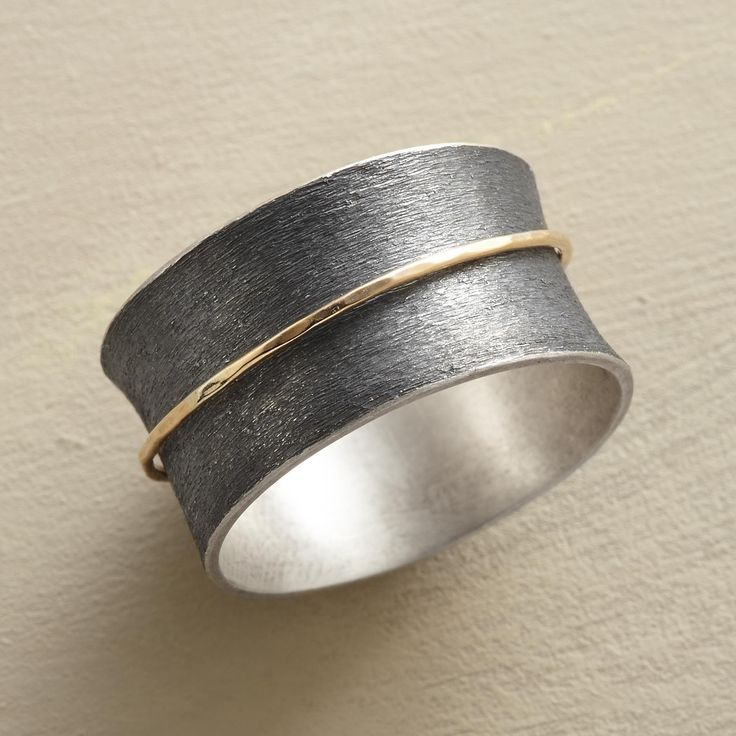 """SPUN INTO GOLD RING--Like a wisp of straw spun into gold, a 14kt ring spins on its base band of etched, oxidized sterling silver. A handmade 14kt gold band spinner ring in whole sizes 5 to 9. 7/16""""W. This ring is licensed under U.S. patent nos. 6,497,117 and 6,395,732."""