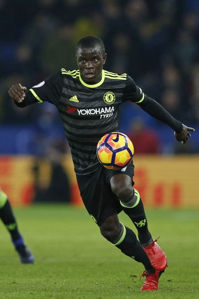 Chelsea's French midfielder N'Golo Kante controls the ball during the English Premier League football match between Leicester City and Chelsea at King Power Stadium in Leicester, central England on January 14, 2017. / AFP / Adrian DENNIS / RESTRICTED TO EDITORIAL USE. No use with unauthorized audio, video, data, fixture lists, club/league logos or 'live' services. Online in-match use limited to 75 images, no video emulation. No use in betting, games or single club/league/player…