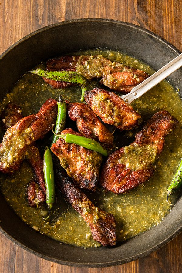 """""""Hatch"""" a plan to smoke this pork and green chili meal for your next summer BBQ. Smoked chilies have a heady deep spice that will add bad ass flavor to smoked pork. You're friends will fight for tongue-tingling seconds."""