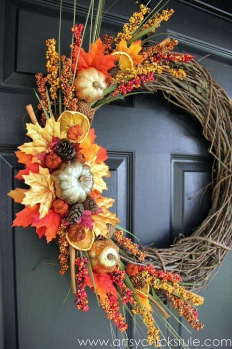 This project piles it all on with fruit, leaves, pumpkins and pinecones, just to name a few components — but just on one side of the wreath. Try an asymmetrical design for something a little more unexpected, and DIY your own dried orange slices by baking them in the oven. Click through for the tutorial and more easy DIY fall wreaths.