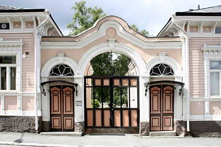 Old gate between wooden houses, Finland