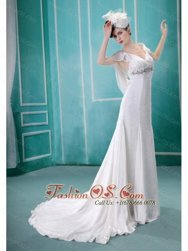 V-neck Neckline Sequins and Rhinestones Decorate Wedding Dress With Short Sleeves  http://www.fashionos.com/  http://www.facebook.com/quinceaneradress.fashionos.us  It's made in an elegant V neckline with chic beaded cap sleeves. The middle part of the waist was decorated with wonderful beadings which cause much attention to this part. The dress is floor length with a elegant train.