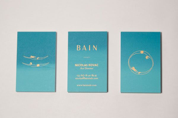 The blue version of the business cards with golden illustrations and lettering.