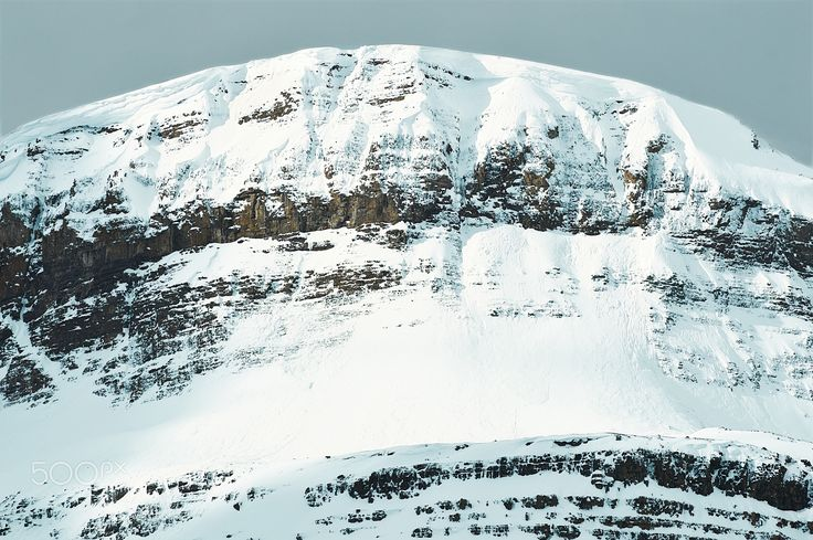 Mount Monument - Snow capped mountain top in winter