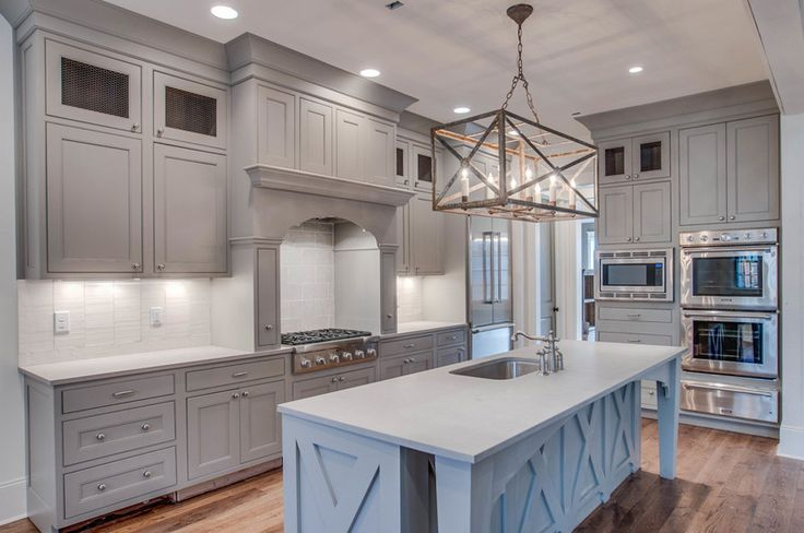 grey kitchen cabinets, white backsplash, stainless steel appliances, barn island, rustic  chandlier