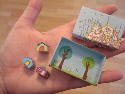tiny houses inside a painted matchbook