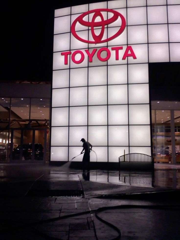 Pressure washing exterior walkways, entryway and show floor for car dealership