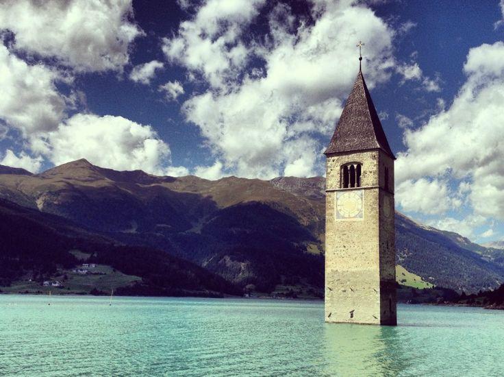 The striking church steeple on Lake Resia