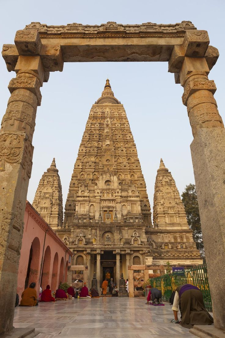 "Mahabodhi Temple, "" The Great Awakening Temple"", is a Buddhist temple in Bodh Gaya, marking the location where Siddhartha Gautama, the Buddha, is said to have attained enlightenment. Bodh Gaya (located in Gaya district) is located about 60 miles from Patna, Bihar state, India."