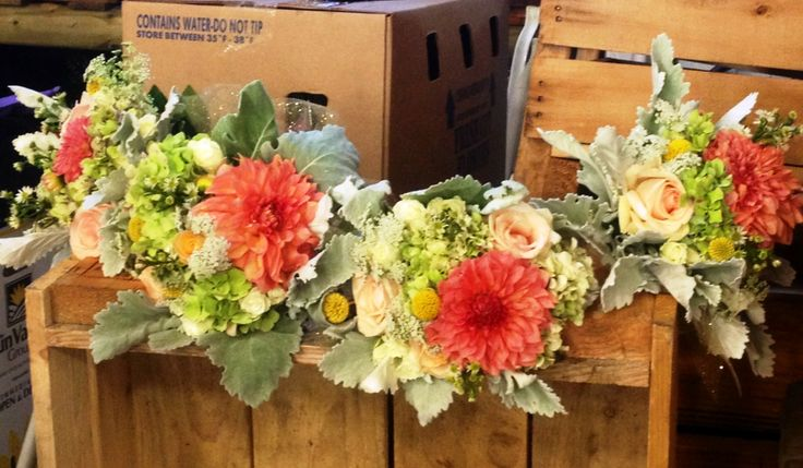 Coral grey wedding bouquets bridesmaids with dusty miller, coral dahlias, billy balls, babies breath, vintage hydrangea, and light peach roses.