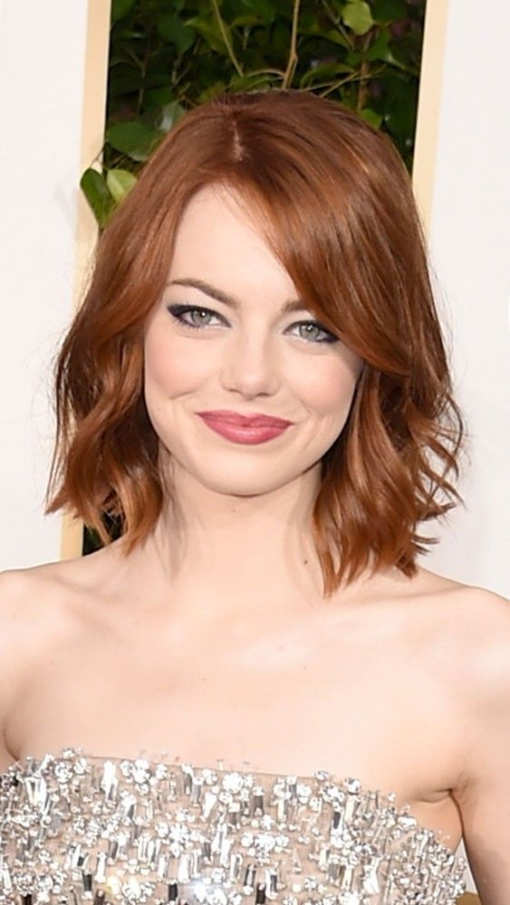 We love Emma Stone's eyeliner with a cool feline flick. See more photographs from Golden Globes 2015 at www.redonline.co.uk.