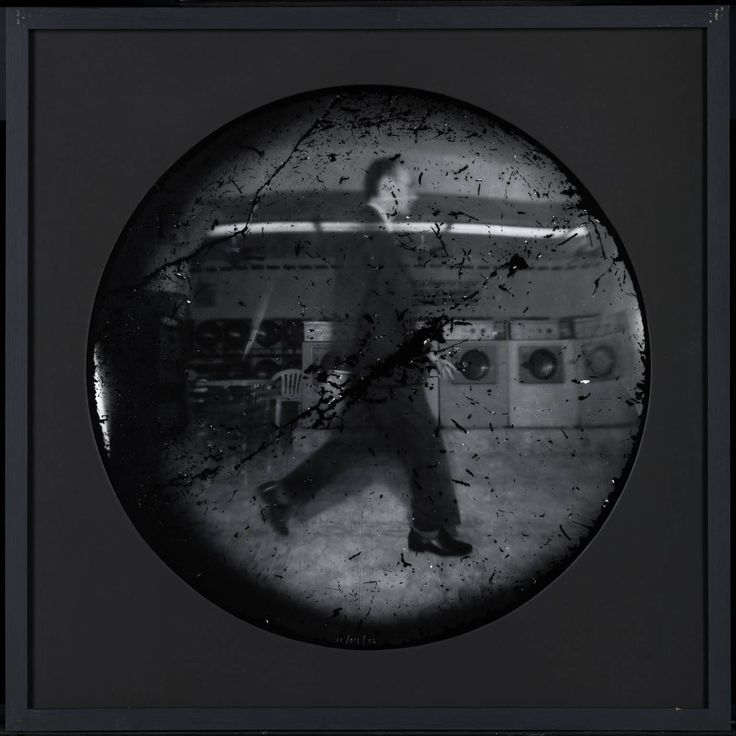 Walking | Steven Pippin explored the walking figure in action. He created this photograph using a very unusual camera – adapted from a washing machine! Pippin experimented with temporarily transforming washing machines into cameras after he had noticed a number of similarities in the workings of washing machines and the development of photographs.