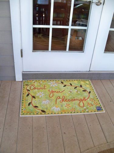 """""""Count Your Blessings"""" floorcloth at the back door."""