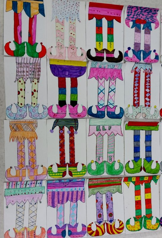 3rd graders designed symmetrical elf legs using markers and crayons and then added details using metallic paint.