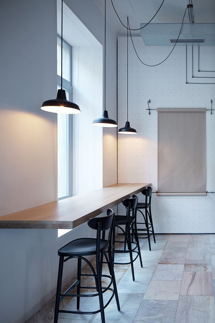 A White Minimalist Bistro In Prague | designed by Mimosa architekti and Modulora