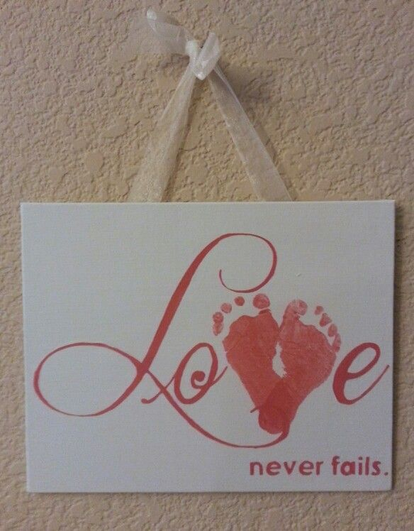 """Valentine's day art craft for infant, toddler, or young kid. """"Love never fails"""" with Baby footprints for 'V'. Painted on 8x10 canvas hung with ribbon super glued on back."""