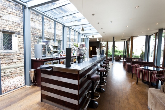 The bar and additional lounging areas for an individuals comfort.