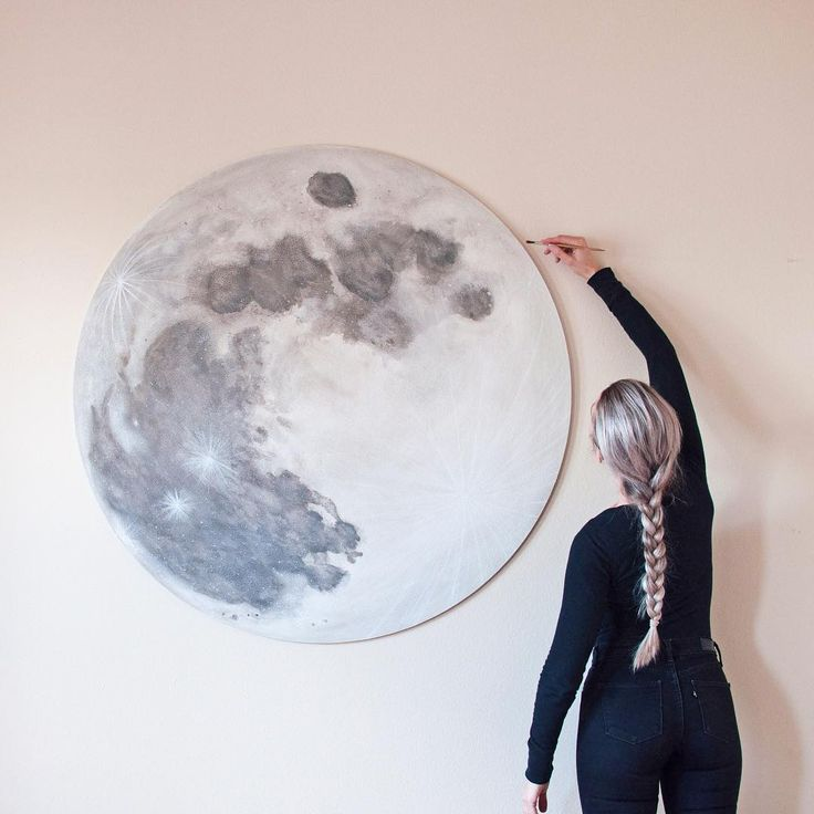"""finishing up the largest moon painting I've ever made.  I've been working on this one for a couple months now, and finally finished it in time for the full moon on Monday night.  Wolf Moon watercolor on wood 47"""" diameter round  this piece was a collaboration with my husband, Seth of @sethreese who made the wood round.  I've loved collaborating with him in the studio"""