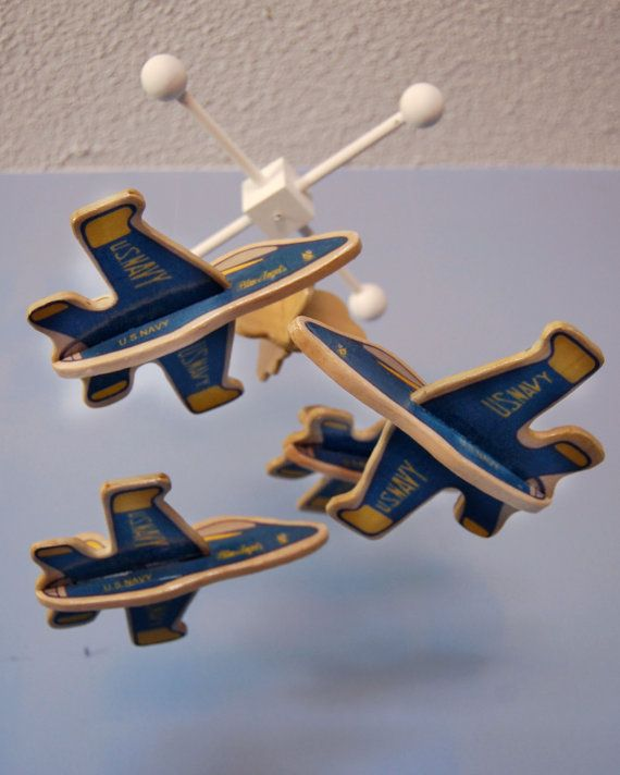 Wooden baby mobile with Blue Angels jets.