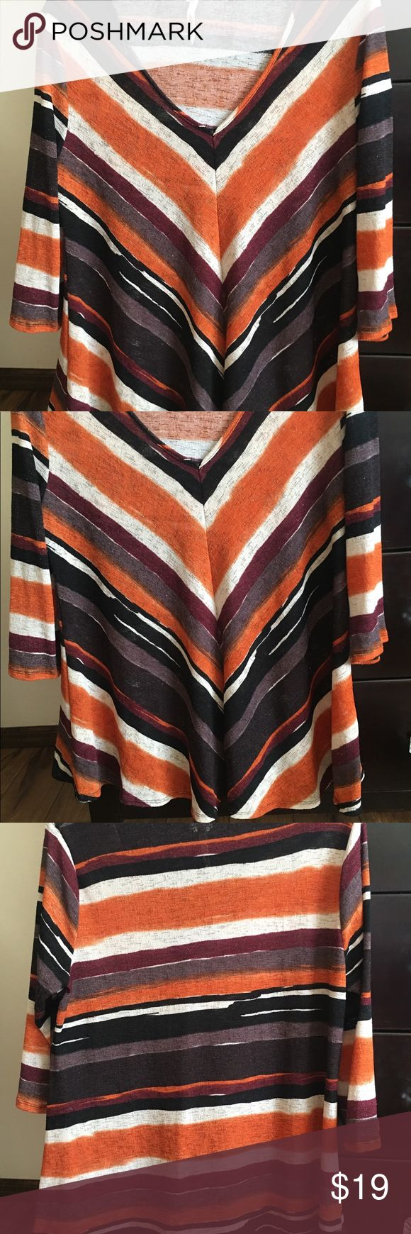 Orange Brown and White Ladies Top Sz XL Orange Brown and White Ladies Top in Size XL. V-neck with seam down the front.  Could fit up to a size 16. Great Fall colors and looks great with black leggings. EUC NY Collection Tops Tees - Long Sleeve