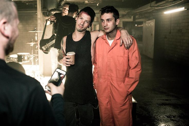 Josh looks like a regular human being but Tyler literally looks like he got taken out of prison to shoot this music video.