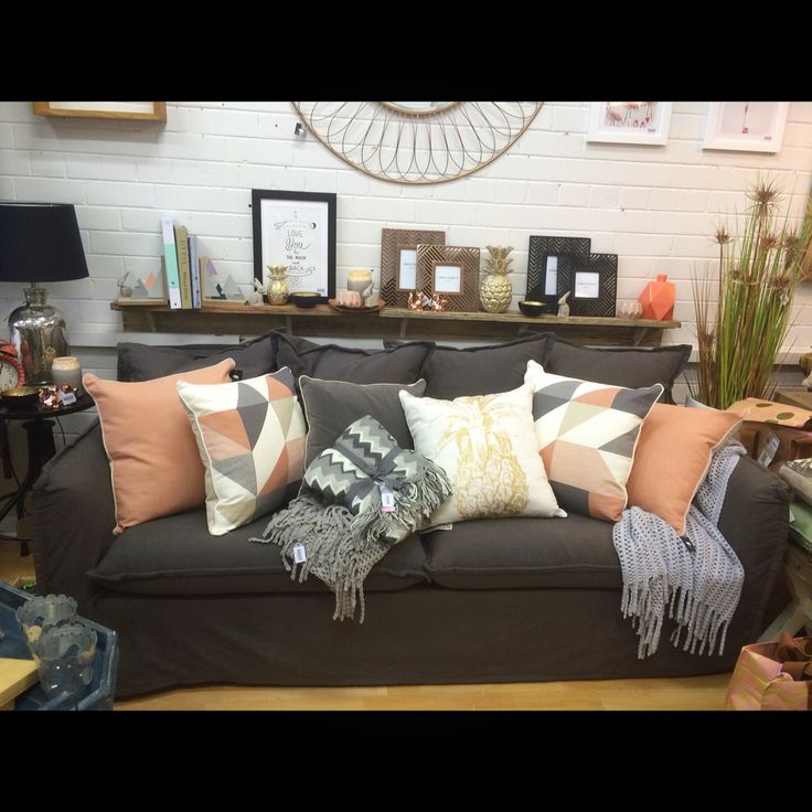 Our amazing new couch on display with coral gold copper for Home decorations melbourne