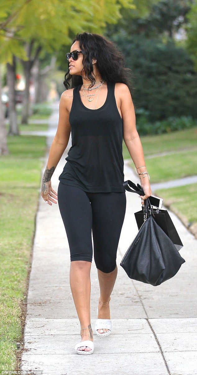 Killer accessories: Rihanna layered several silver necklaces, bangles and anklets to add interest to her look