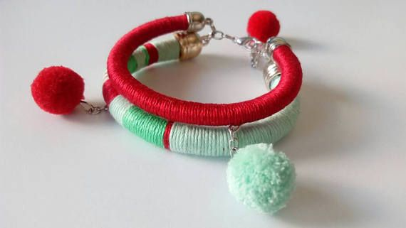 Hey, I found this really awesome Etsy listing at https://www.etsy.com/listing/526533544/red-pom-pom-tribal-bracelets-african