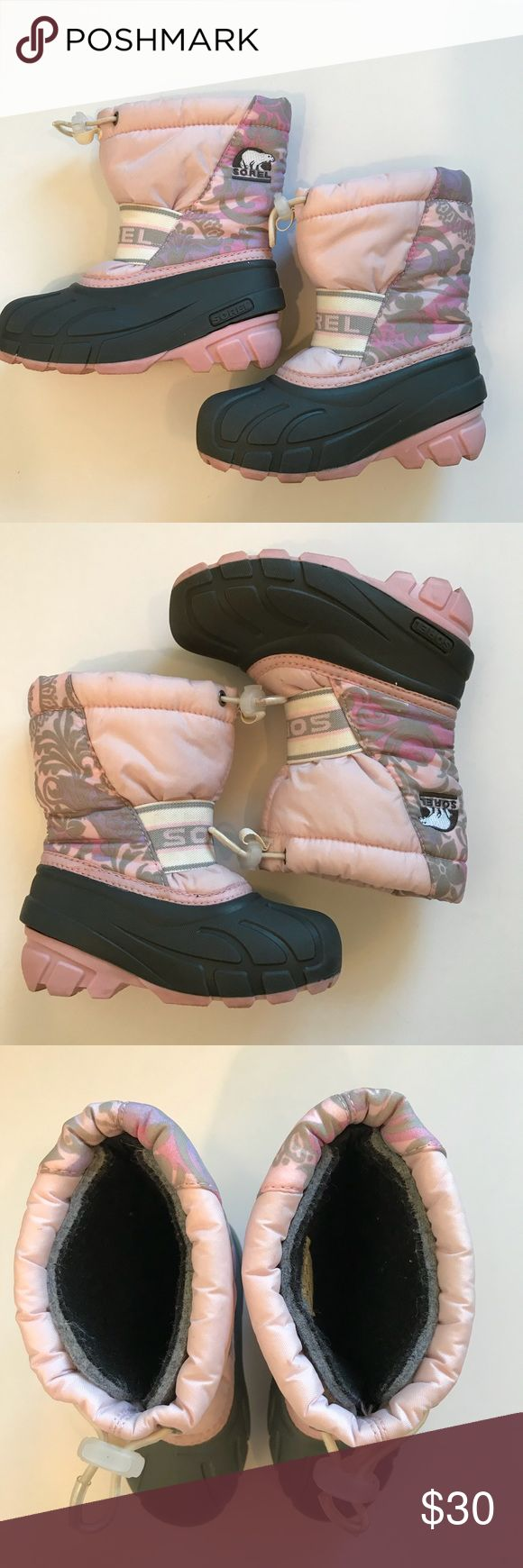 Sorel boots Sorel snow boots. Size 10. Great for the snow. Cute print pink and gray. Very good condition. Sorel Shoes Rain & Snow Boots