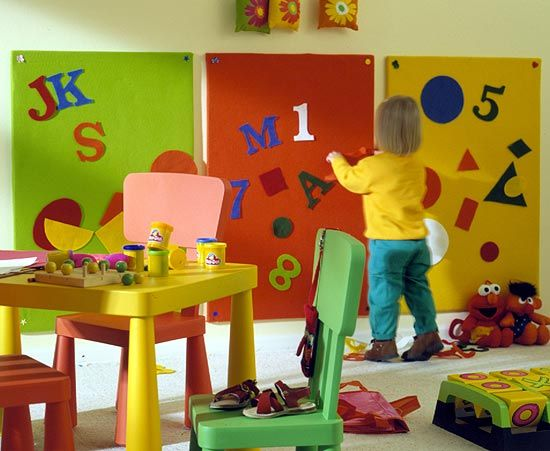 Cheery felt-covered boards hung at toddler-height sport oversized letters, numbers, and shapes.    The fun felt cutouts beg little ones to put together a word or two. There's nothing magical here. Friction holds the shapes to the board, just like it did in kindergarten class.