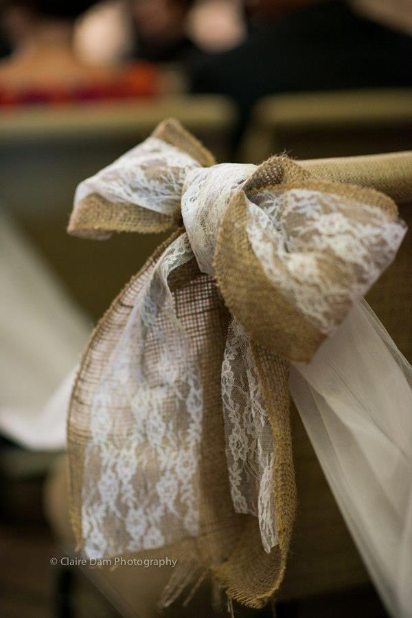 handmade burlap & lace bows at the church. Maybe Purple wine bottles w/ babysbreath sitting beneath them?