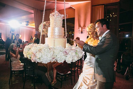 Suspended wedding cake?  Anything's possible!  We have some fabulous friendors that have pulled off this look and engineering before.