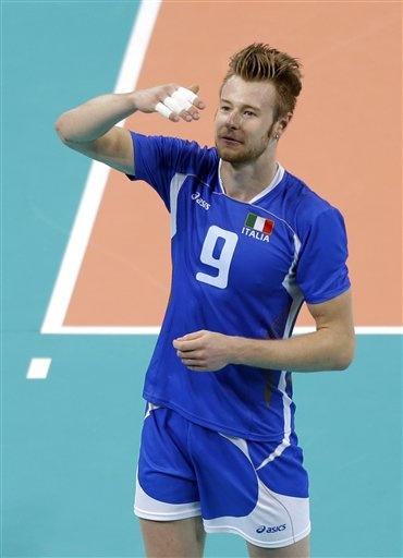 Italy's Ivan Zaytsev (9) blows a kiss to the crowd after the team's 3-0 win over the USA