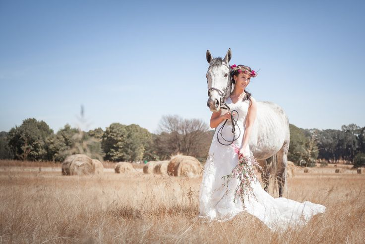 I took this photo out in some fields with bales of hay. We managed to find a horse for this bridal shoot. Our model is a professional horse rider so we thought there could be nothing better than to have a horse in these pretty bridal portraits