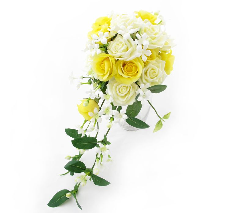 A trail of yellow Fresh Touch roses, cream Classic roses and stephanotis. Find your perfect wedding flowers at http://www.loveflowers.com.au
