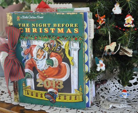 """Debbie Schuh's darling book using the Little Golden book, """"The Night Before Christmas"""" as the foundation of our project. We'll take the book apart and then refashion it with Christmas papers from five different companies, making interactive pages with fold-outs and pockets and page protectors and a variety of embellishments to fill our books with nostalgic whimsy!"""