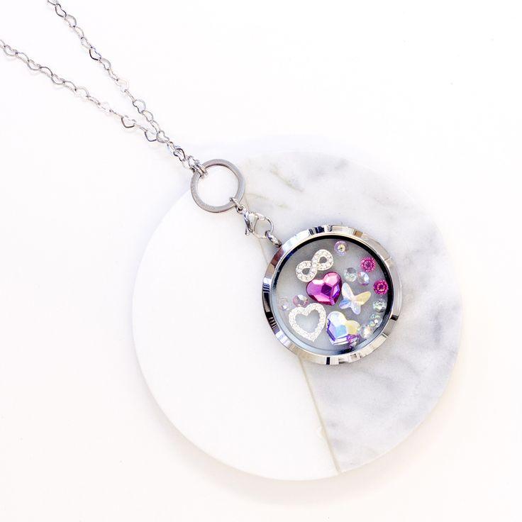 Classic Silver Lockets filled with charms and Swarovski Crystals   #lovelockets #jewellery #jewelry #locket #charms #crystals #swarovski #sparkly #gift #giftideas #instafashion #instagram #floatingcharms #pandora #thomassabo