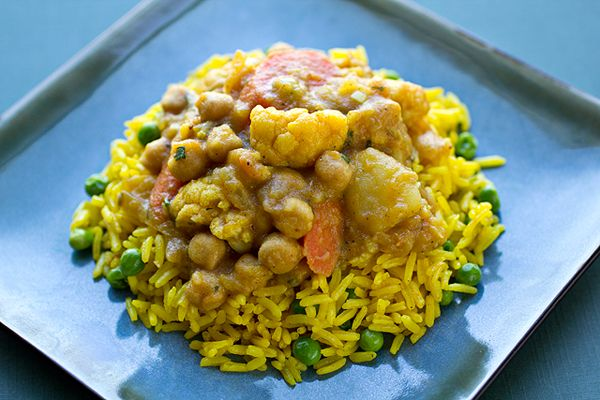 Golden, Curried Vegetable Stew with Cauliflower, Potatoes, Chickpeas and Carrots over Turmeric Rice