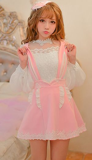 Adorable pink bunny ear brace skirt with concealed satin bloomer shorts. Adjustable shoulder straps that are the shape of bunny ears with a cute removeable fluffy bunny tail to the back. The pink skirt has white flouncy trim and an embroidered lace hem with embroidery along the waist line.
