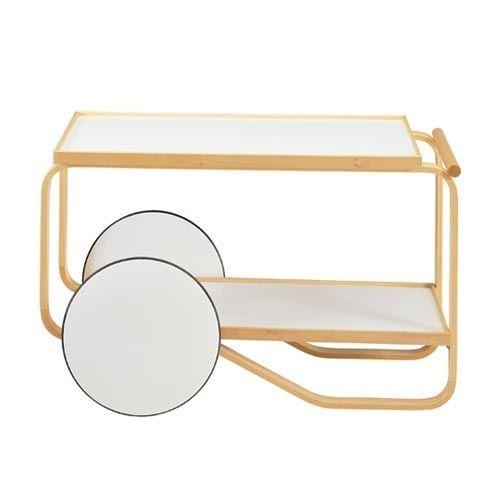 Carrello con telaio di betulla a nastro; Ripiani in laminato plastico bianco o nero. Ruote in laminato plastico bianco. Designers: Alvar Aalto e moglie Aino.