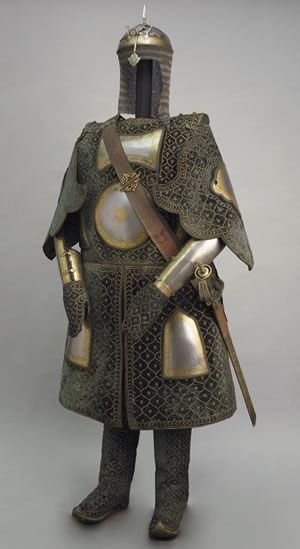 'Coat of a thousand nails', made up of layers of fabric faced with velvet and studded with numerous small brass nails, which were often gilded. The padded coat, minus its nails, is known for short as a chilta and was worn over armour or on its own. Fabric armour was very popular in India because metal became very hot under the Indian sun.