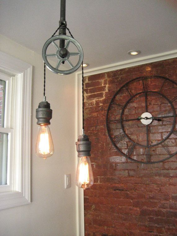 This overhead steel pulley lamp. | 18 Steampunk Decor Flourishes That Will Make Any Room Badass