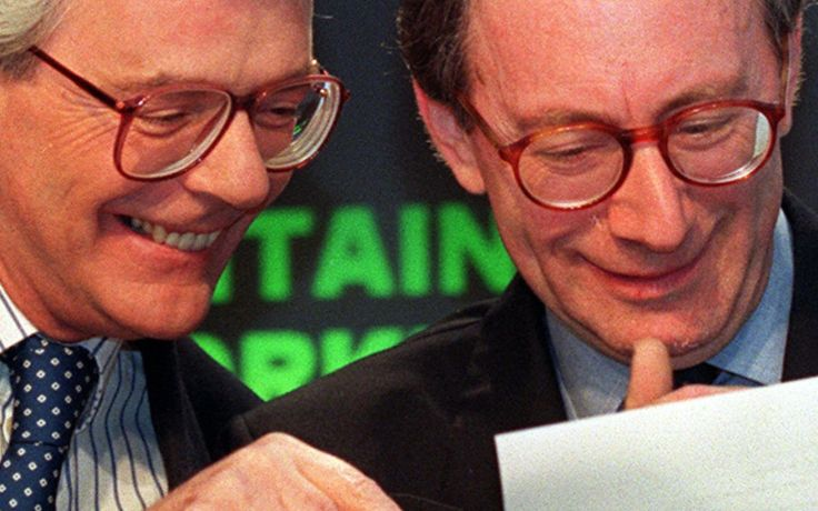 Ex British Prime Minister John Major (L) and ex Foreign Secretary, Malcolm Rifkind, share a light-hearted moment, during their morning election conference in London