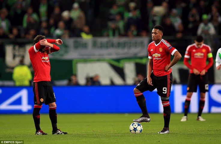 Juan Mata (left) and Martial look dejected before the restart after Manchester United had fallen behind to Vieirinha's goal