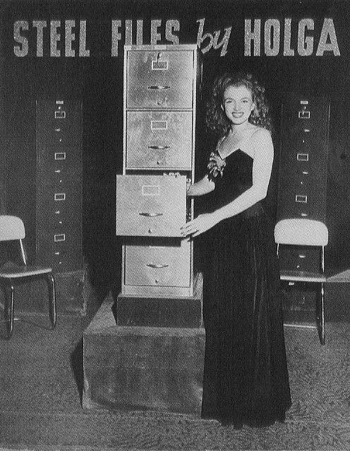 1945 Norma Jeane as hostess