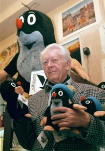 (CTK, Stan Peska, file/Associated Press) - FILE- In this March 1999 file photo, Czech animator and illustrator Zdenek Miler poses with his most popular character named Mole, in Prague. Miler died on Wednesday, Nov. 30, 2011, aged 90. The animated cartoon character Mole has enchanted millions of children around the world and even made it into space on a NASA shuttle, and now Mo;e will outlive the life of his character.