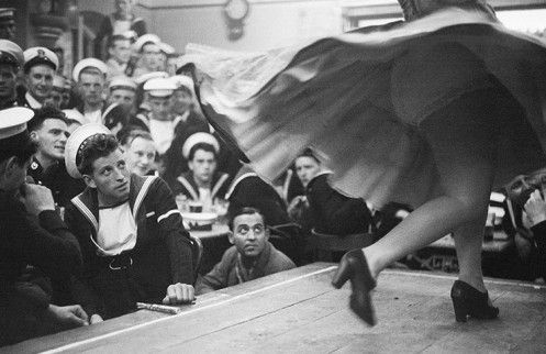 Bert Hardy exhibition:  British sailors taking shore leave on Gibraltar visit the Suiza Bar to watch a Spanish dancer perform.